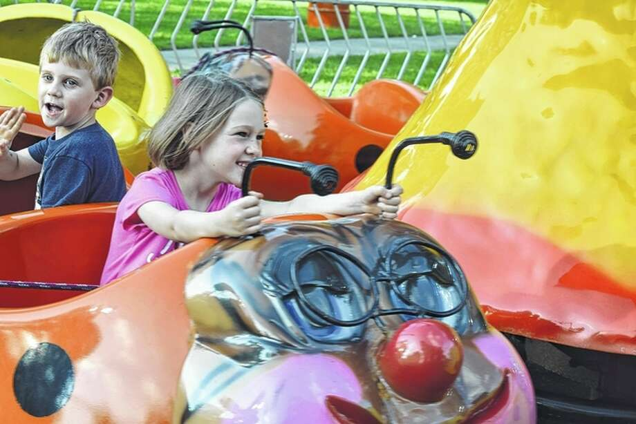 Josie Day, 6, of Dustin and Deanne Day, and William Edwards, 5, of Stephanie Bagley and Steve Edwards, ride a lady bug ride Friday at the Waverly Community Picnic. Photo: Samantha McDaniel-Ogletree | Journal-Courier