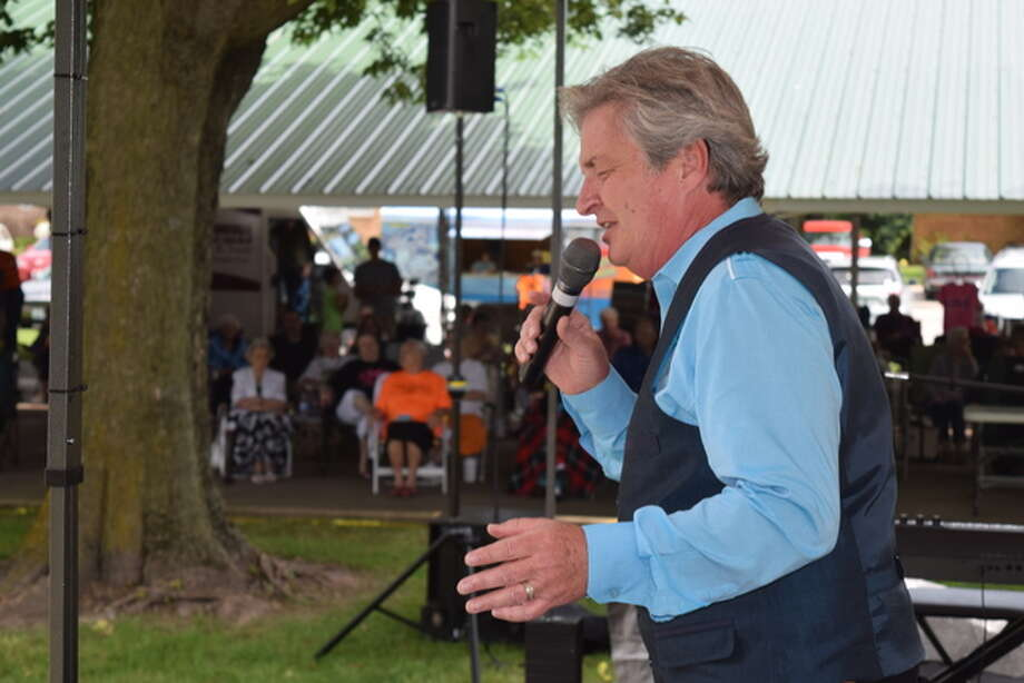 Woody Wright of Alexandria, Indiana, sings Saturday during the Manchester Gospel Music Festival. The free event continues today in Manchesteer Village Park.