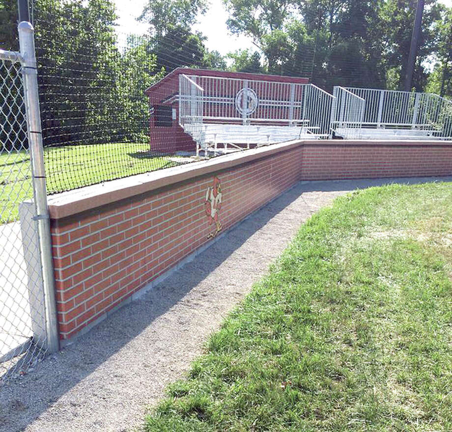 "A portion of the backstop and bleachers at the Alton Middle School baseball field, which was renovated in 2014. Monday at 3:45 p.m., the field will be named in memory of former Alton baseball coaching great Wayne D. ""Bud"" Tyler Photo: Telegraph File Photo"