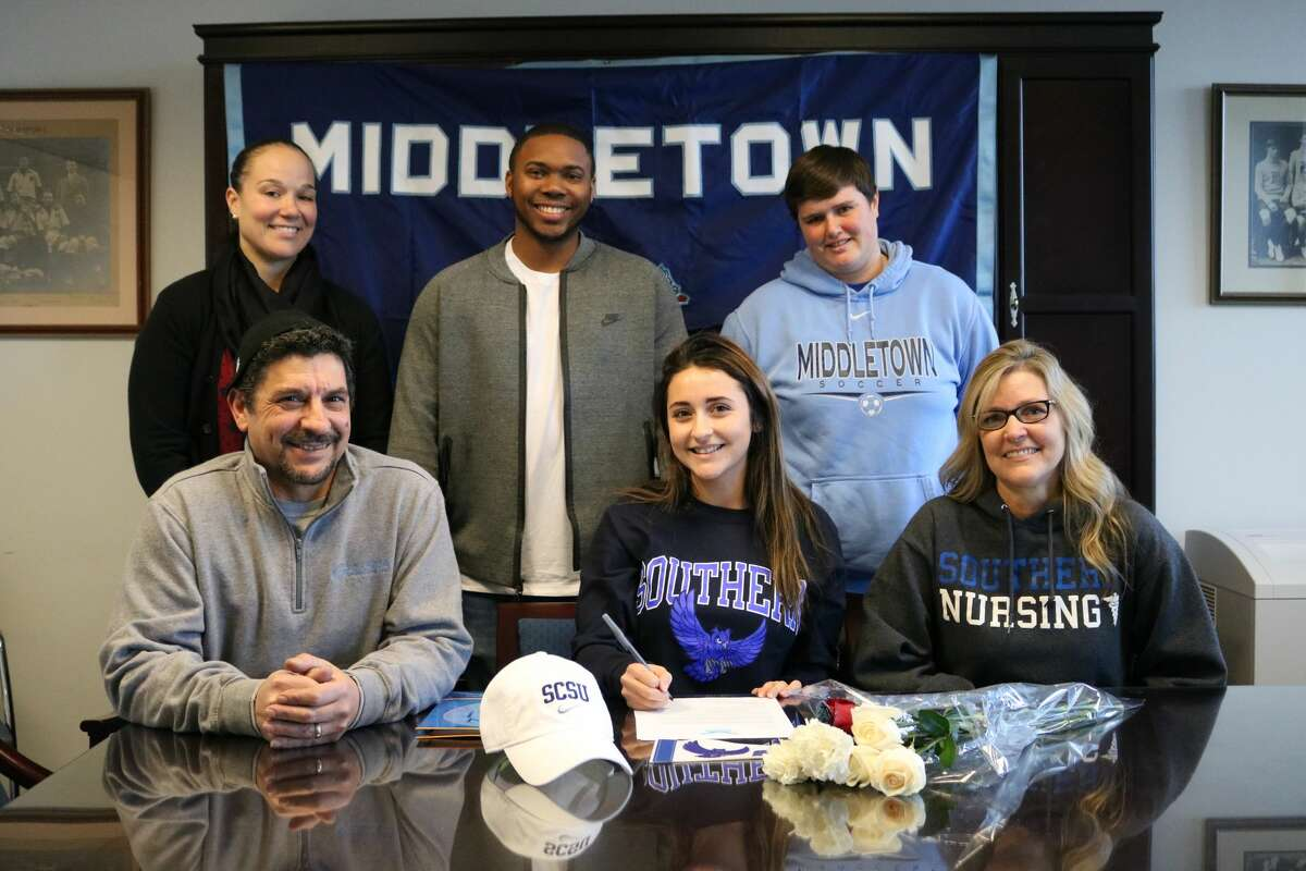 Kaitlyn D'Amico, a senior at Middletown High School, has committed to play soccer at Southern Connecticut State University. She is seated with her father, Bruno D'Amico, and mother,Cheryl D'Amico.Athletic DirectorElisha De Jesus , coach Jarice Manson, and Middletown girls soccer coach Rachel Lemke are standing.