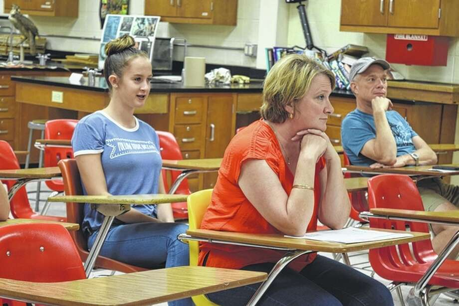 Cierra Aherin, a freshman at Jacksonville High School, and her mother Susan Aherin listen as her biology teacher explains some of the things they will be learning throughout the year Wednesday at the Jacksonville High School open house. Photo: Samantha McDaniel-Ogletree | Journal-Courier