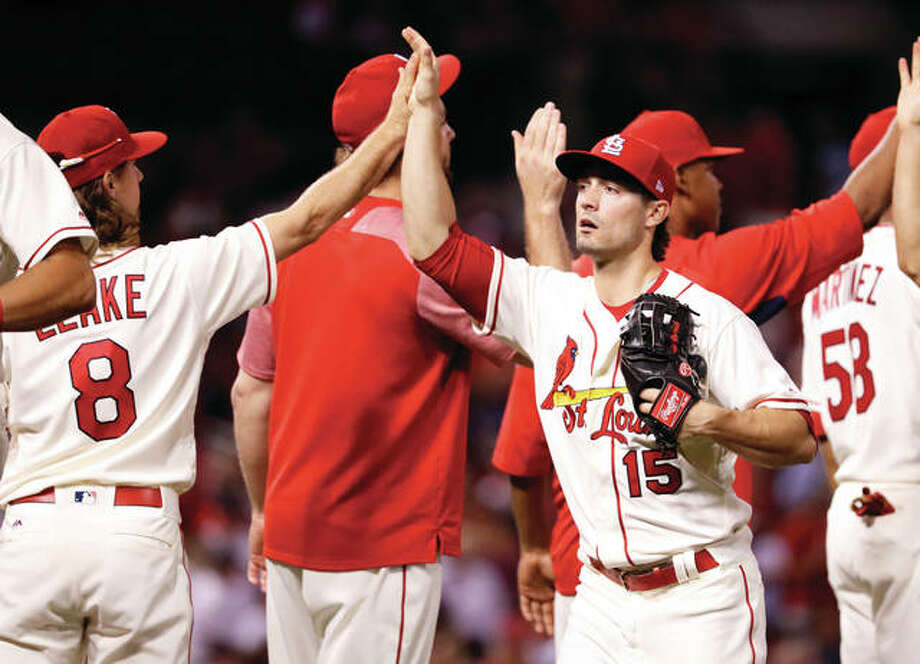 The Cardinals' Randal Grichuk (15) celebrates with teammates following a 6-5 win over the Atlanta Braves on Saturday night at Busch Stadium. It was the Cards' eighth victory in a row. Photo: Associated Press