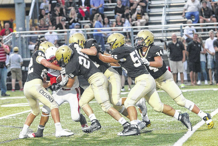 While returning a ball following a Sacred Heart-Griffin touchdown, defensive lineman Jordan Dossett fends off five SHG players to advance the ball. He was ultimately taken down on the 10-yard-line. Photo: Andrew Drea | Journal-Courier