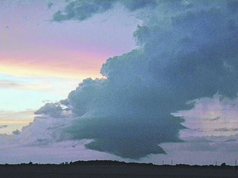 A small storm cloud pops up at sunset west of Jacksonville. Photo: David Blanchette | Reader Photo
