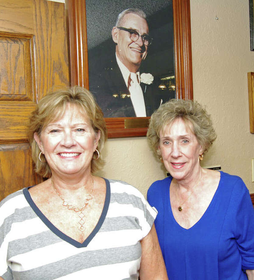 Sue Nagy and Carol Nasello pose with a portrait of their father and the founder of the Owl's Club, Glenn Borman. Photo: Photos By David Blanchette | For The Telegraph