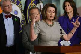 WASHINGTON, DC - FEBRUARY 08:  House Minority Leader Nancy Pelosi (D-CA) (3rd L) talks to reporters while announcing the House Democrats' new infrastructure plan during a news conference with (L-R) Rep. Earl Blumenauer (D-OR), Rep. David Cicilline (D-RI) and Rep. Cheri Bustos (D-IL) at the U.S. Capitol February 8, 2018 in Washington, DC. Pelosi said the $20 billion in infrastructure spending over two years in the current federal budget deal is 'a diversionary tactic.'  (Photo by Chip Somodevilla/Getty Images)