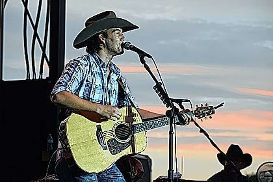 Concert in the Cornfield's opening act, rising country music star William Michael Morgan, performs Saturday near the cornfield on Comfort Drive in South Jacksonville. Headliner Craig Morgan followed Morgan on stage. Photo: Greg Olson | Journal-Courier