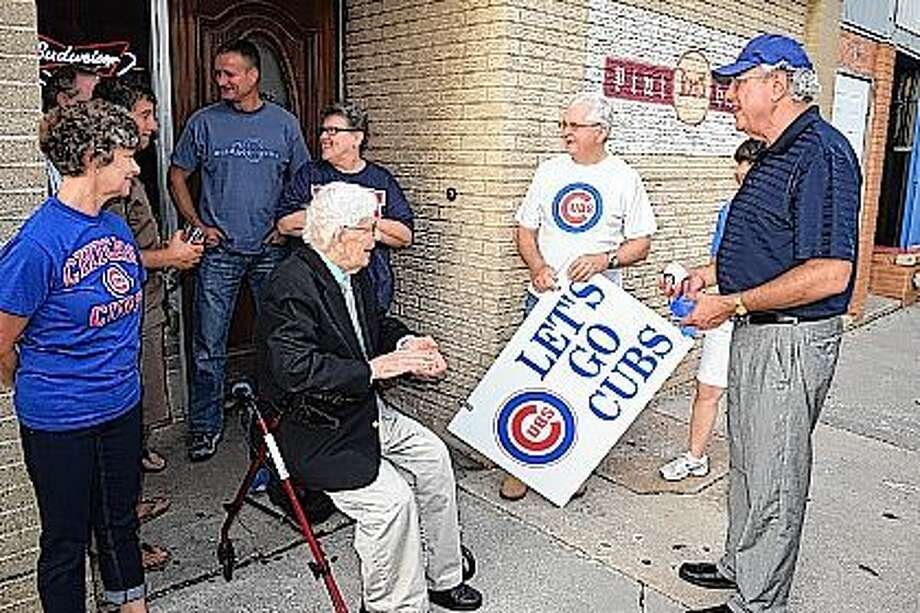 Jacksonville-area fans of the Chicago Cubs gathered Tuesday evening at KJB's Pint Haus on East State Street. Talking after a ribbon-cutting ceremony were Barb Davenport (from left), an unidentified Cub fan, Todd Behrends, Paul Findley, Diana Spradlin, Craig Findley, Mary Kay Fiorito and Larry Kuster. Photo: Greg Olson | Journal-Courier