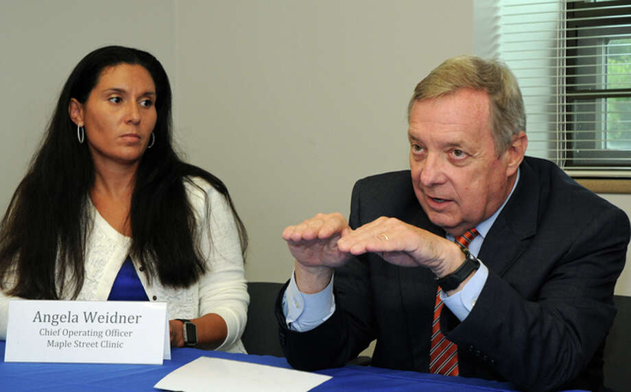 Angela Weidner, chief operating officer of Maple Street Clinic, listens to U.S. Sen. Richard Durbin during a visit to the clinic Monday to discuss opioid and heroin addiction treatment. Photo: David Blanchette | Journal-Courier