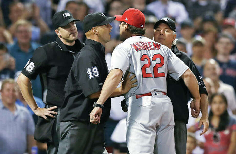 Cardinals manager Mike Matheny (22) is held back as he argues with umpire Chris Segal, left, after being ejected in the ninth inning of Wednesday night's 5-4 loss to the Red Sox at Fenway Park. Photo: AP