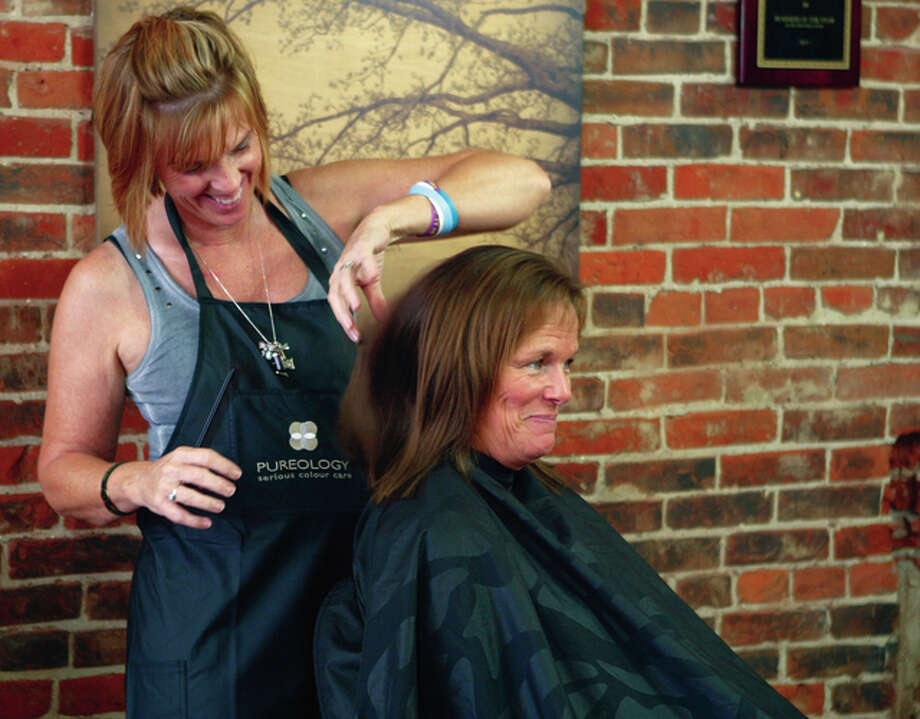 Inner Harmony owner Cheryl Kearns gives Sharon Kassing of Mount Sterling a hair cut on Thursday. Inner Harmony will be celebrating its 10th anniversary with a charity vendor event Friday. It will include a book signing with Nancy Long and photography by Lacey Matthews. Proceeds will be given to New Directions Warming and Cooling Center. Photo: Samantha McDaniel-Ogletree | Journal-Courier