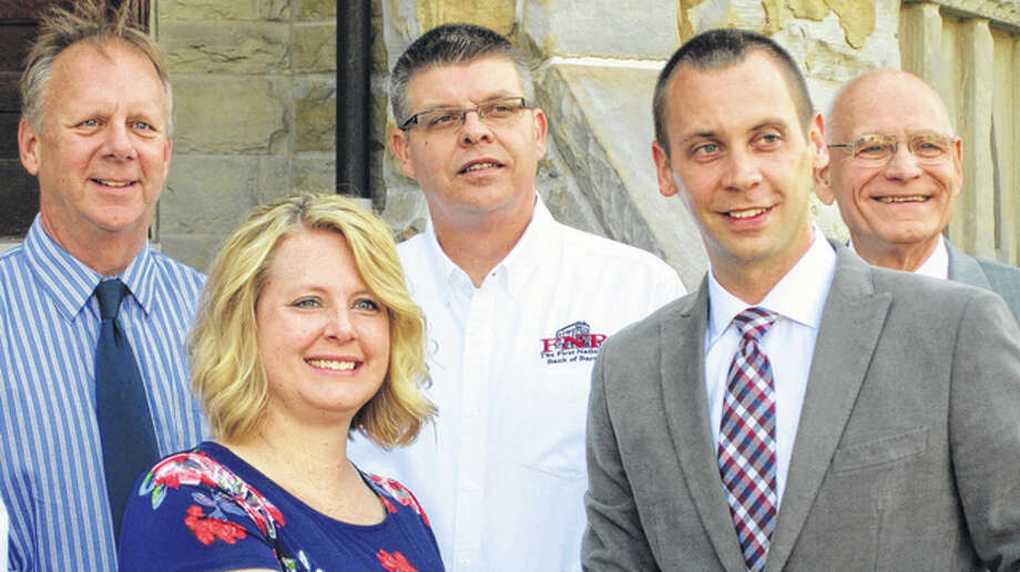 Megan Newman (left, center) was among those accepting a grant from Brian Nation (right, center) on behalf of the Pike County Dental Clinic as Dan Borrowman, Robert Garner and Don Kirk watched on from the steps of the Pike County Courthouse on Thursday. Photo: Photo Provided
