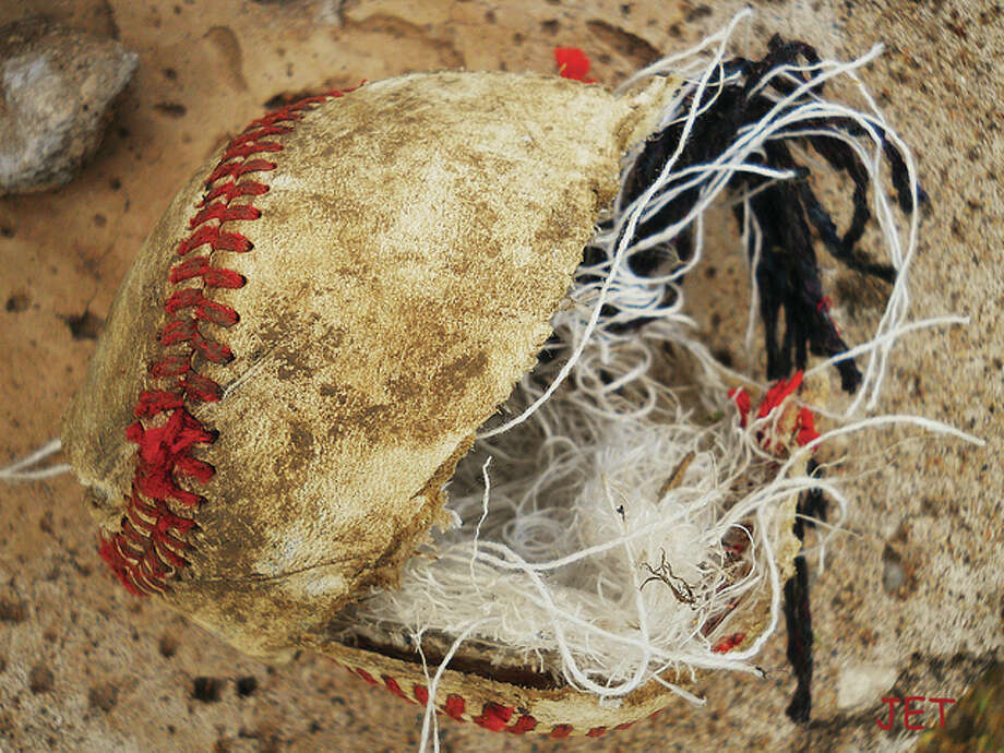 A baseball shows the signs of a long, hot summer of action.