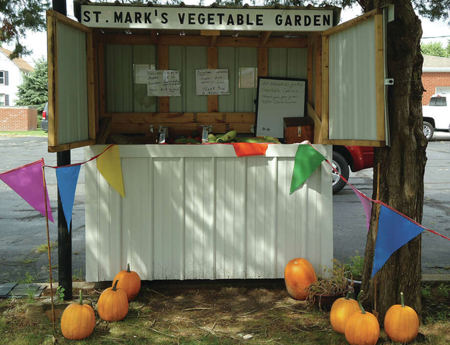 St Mark's Church offers fruits and vegetables for sale at a booth in Winchester. Proceeds go to charity.