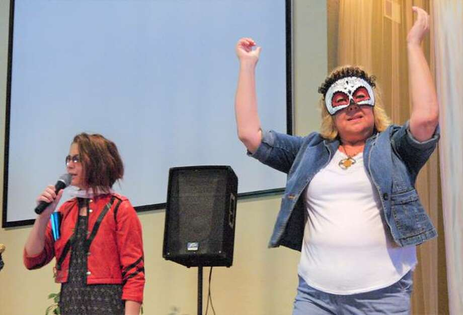 "Dorie Bechel and her grandmother Doreen Bechel, a duo known as ""The Generics,"" perform Queen's ""We Will Rock You"" during Saturday's Lip Sync Battle to benefit Amare. Photo: Photos By David Blanchette