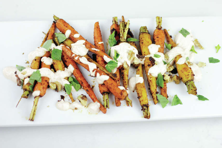 Moroccan spiced carrots with yogurt sauce adds a bit of zest to what can be a bland vegetable. Photo: Melissa D'Arabian | Associated Press
