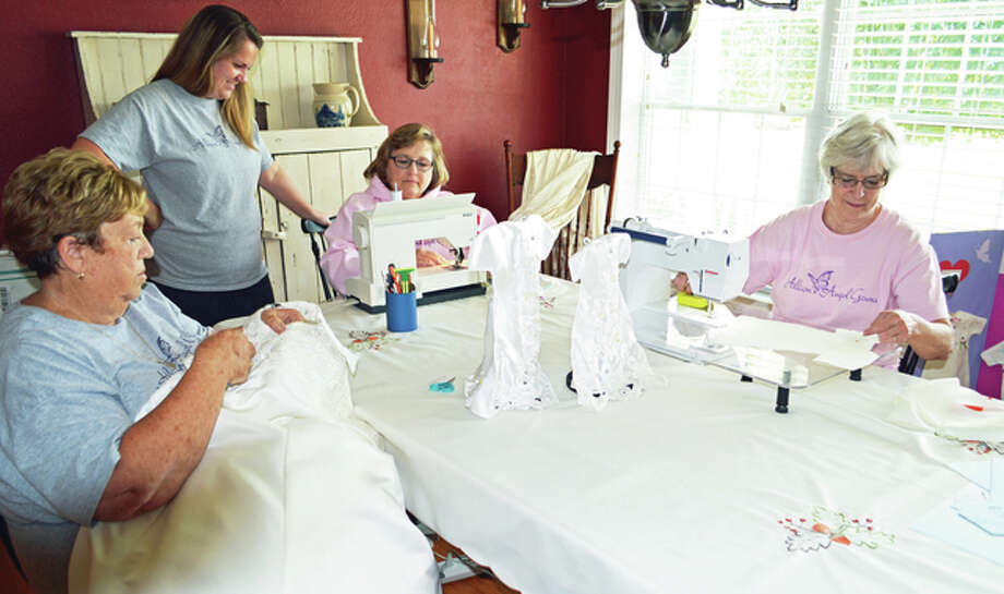 Brenda Nurnberger (left) of Brighton, Janet Scheller, Chris Taul of Jerseyville and Kathie Daugherty of Wood River gather to make bereavement gowns for Allison's Angel Gowns, a non-profit organization started by Scheller in memory of her daughter. Photo: Vicki Bennington | Special