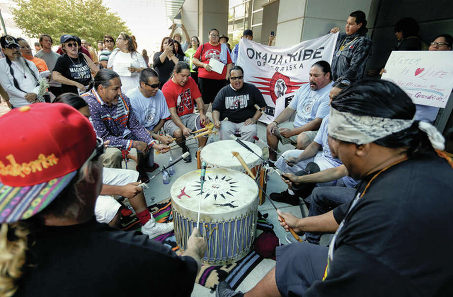Members of the Ponca, Santee, Winnebago and Omaha tribes in Nebraska and Iowa, along with others, participate in a rally Thursday in front of the Army Corps of Engineers offices in Omaha, Nebraska, to protest against the Dakota Access Pipeline.