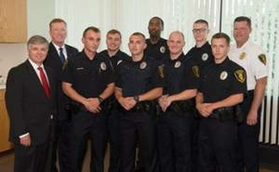 SIUE Chancellor Randy Pembrook, Vice Chancellor for Administration Rich Walker, Dylan Koke, Larry Bowles, Travis Hoguet, Kelly Waters, Tyler Gallaher, Dalton Archer, Anthony Hettinger and SIUE Police Chief Kevin Schmoll.