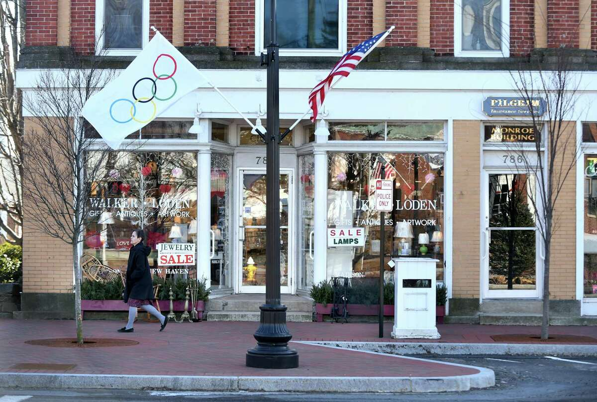 Olympic flags are displayed in downtown Madison on February 8, 2018 in support of the three Madison athletes competing in the Winter Olympics.