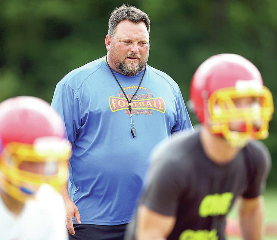 Roxana Shells head coach Pat Keith leads his team through drills. Photo: Telegraph File Photo