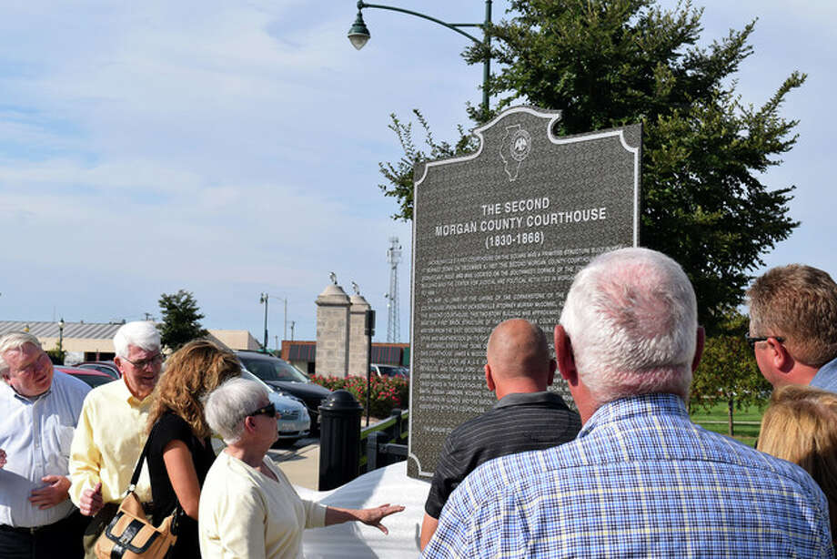 A marker commemorating the second Morgan County Courthouse, which was used from 1830 until the existing courthouse was built in 1868, was dedicated Tuesday in Central Park. The marker is in memory of former Jacksonville Mayor Ron Tendick, who suggested it in 2011. The courthouse was the center of legal and political activities that involved governors, judges, attorneys as well as Abraham Lincoln and Stephen Douglas. The marker was sponsored by the Illinois State Historical Society, the Morgan County Historical Society, the city of Jacksonville and Morgan County. Photo: Greg Olson | Journal-Courier