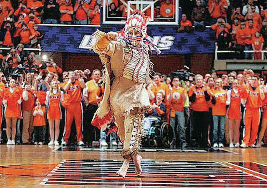 "In this 2007 file photo, University of Illinois mascot Chief Illiniwek performs for the last time during an Illinois basketball game in Champaign. Illinois has announced that the school is ending its tradition of playing ""war chant"" music during sporting events. Athletic department spokesman Kent Brown said the Illini made the decision in an effort to be more inclusive and because students haven't responded to it as much at football games. The music stems from the school's former mascot, Chief Illiniwek, a tradition that ended in 2007. Photo: Seth Pearlman 