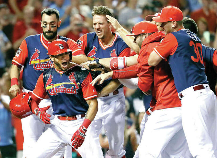 The Cardinals' Tommy Pham, second from left, is is congratulated by teammates after hitting a walk-off two-run home run to defeat the Tampa Bay Rays 6-4 Saturday at Busch Stadium. Photo: Jeff Roberson | AP Photo