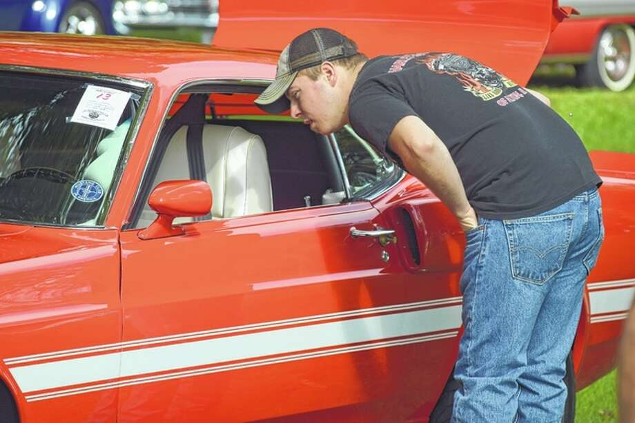 Nick Groscio of White Hall checks out a 1969 Shelby during the car show portion of Saturday's 32nd annual Jacksonville Cruise Nite and Car Show.