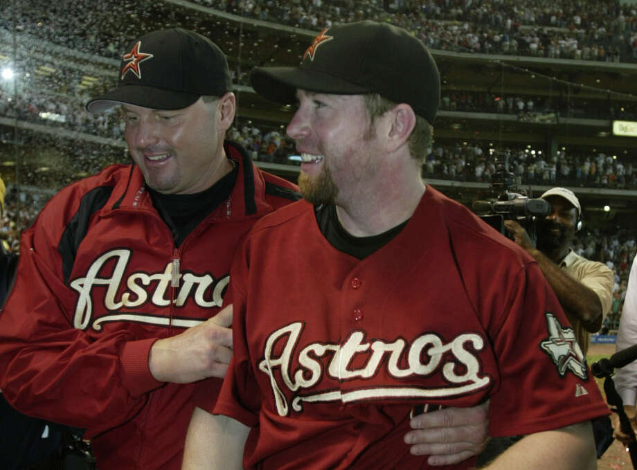 Jeff Bagwell and Roger Clemens walk back to the clubhouse after the Houston Astros-Chicago Cubs MLB game at Minute Maid Park, Sunday, October 2, 2005. Astros Clinched the wild card. (Karen Warren/Houston Chronicle) Photo: Karen Warren/HOUSTON CHRONICLE