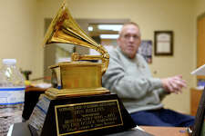 """Don Rollins, band director at Vidor High School, with his Grammy Award for co-writing """"It's 5 O'Clock Somewhere"""" by Alan Jackson and Jimmy Buffet.  Photo taken Thursday 2/8/18 Ryan Pelham/The Enterprise"""