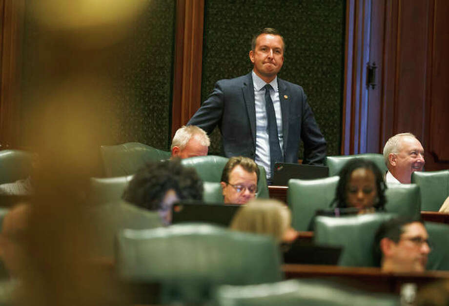 State Sen. Andy Manar, D-Bunker Hill, watches the debate on the education funding bill from the floor of the Illinois House during a special session at the Illinois State Capitol, Monday in Springfield, Ill. The Illinois House approved the education funding plan Monday that will increase state money for all districts, reduce disparities between rich and poor schools and provide $75 million in tax credits for people who donated to private school scholarships. Photo: Justin L. Fowler/The State Journal-Register Via AP
