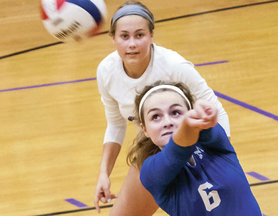Marquette setter Peyton Kline (6) bump sets during the Explorers' three-set victory over the Civic Memorial Eagles on Wednesday night in Bethalto. Photo: Nathan Woodside / For The Telegraph