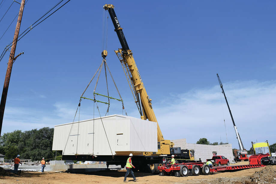 Workers from A.C. Jones Construction of Beardstown use a crane to guide a 72,000-pound backup generator from Oberland Electric onto a concrete pad at Jacksonville's new water treatment plant. The generator will be able to power the $30 million plant for about 24 hours in an emergency. Photo: Nick Draper | Journal-Courier