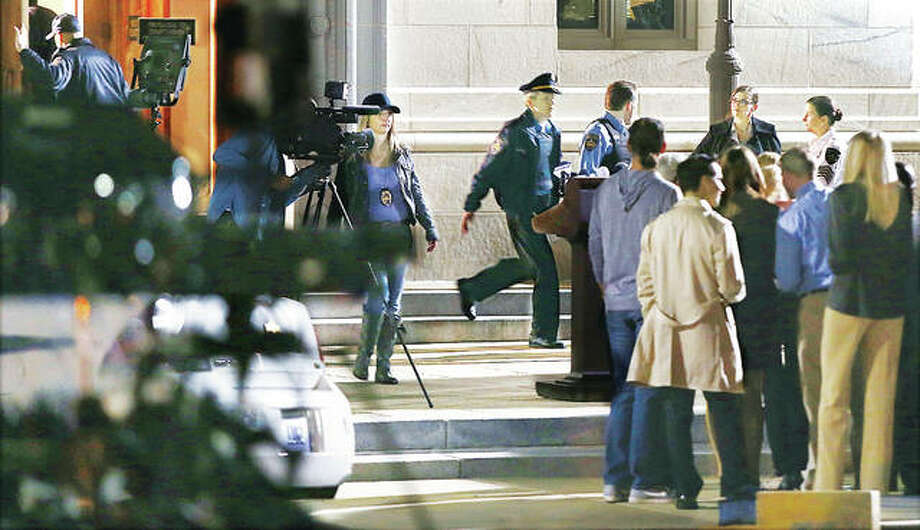 "A scene from the 20th Century Fox movie, ""The Empty Man"", plays out late Thursday night and into early Friday morning where filmakers were doing scenes in and around the Madison County Courthouse in Edwardsville. Here actors appear to be walking past a crowd of reporters on the east side of the courthouse which was being used to portray a police station in the movie."