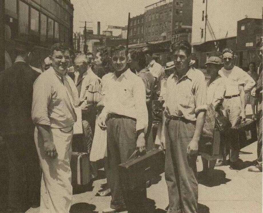 The young men of Alton turned out to fight in World War II. This group of draftees await to board the Interurban to St. Louis in 1942. Photo: File Photo