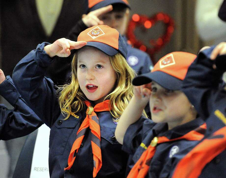 New Cub Scout Charlotte DiPreta does the scout salute during her Boy Scouts of America, Greenwich Council, Pack 23 of North Mianus, induction ceremony for nine girls, including DiPreta, as new Cub Scouts at North Mianus School in Greenwich, Conn., Thursday night, Feb. 8, 2018. Photo: Bob Luckey Jr. / Hearst Connecticut Media / Greenwich Time