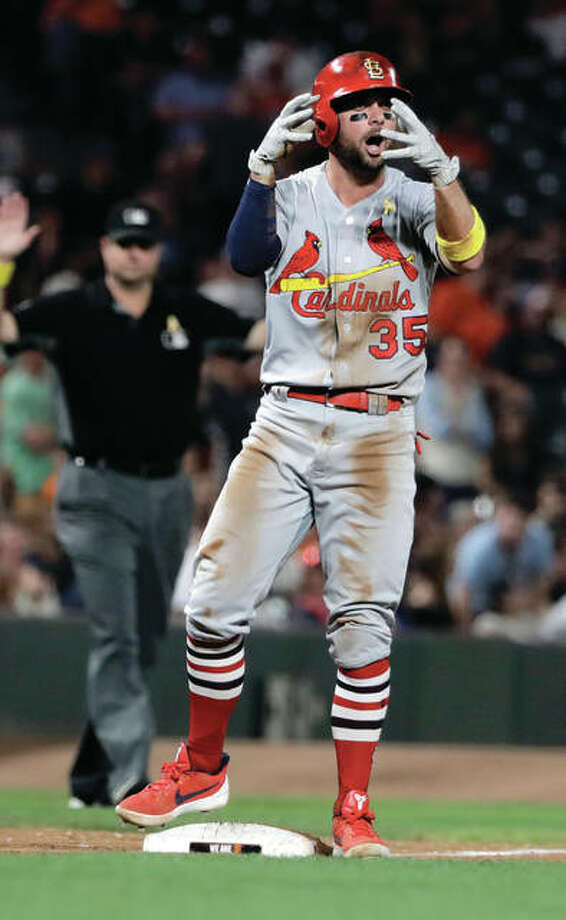 The Cardinals' Greg Garcia reacts after driving in the game-tying run with a triple during the eighth inning against the San Francisco Giants on Friday in San Francisco. Photo: Associated Press