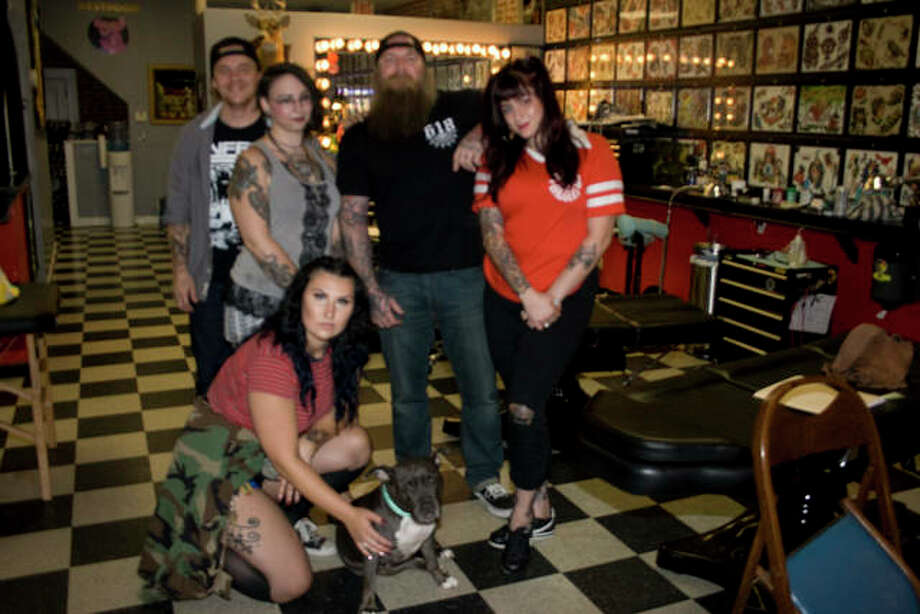 """From left, tattoo artists Jeremy Baker, Kayla White, Kyle Hulker, Autumn Santoni and (bottom) Megan Indelicato keep busy giving local patrons high-quality ink jobs. Shop dog """"Fran"""" keeps them company."""