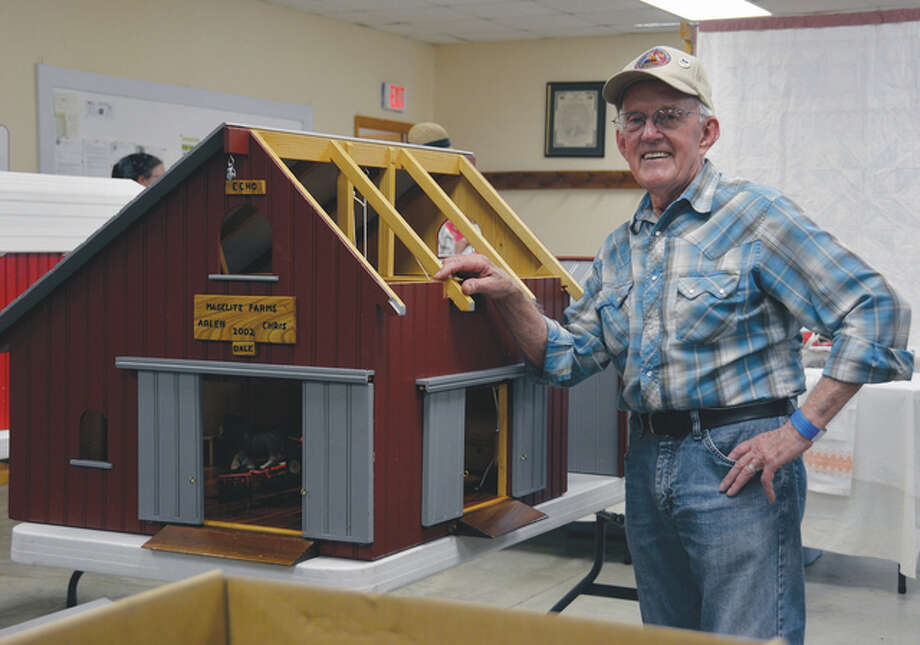 Paul Elliott of Waverly displays a replica barn he made for his grandchildren. He was taking part in weekend events at Prairie Land Heritage Museum. Photo: Kathy Caruthers | Reader Photo