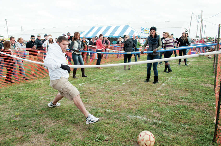 People participate in a game of human foosball during the Jacksonville Rotary Club's Oktoberfest 2015. Oktoberfest returns on Saturday to the Morgan County Fairgrounds in Jacksonville. Photo: Darren Iozia | Submitted Photo