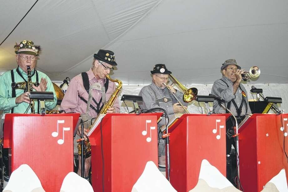 Members of the Heidelberg German Band perform at Oktoberfest Saturday at the Morgan County Fairgrounds. Oktoberfest is one of the Rotary Club's largest fundraisers. Photo: Samantha McDaniel-Ogletree | Journal-Courier