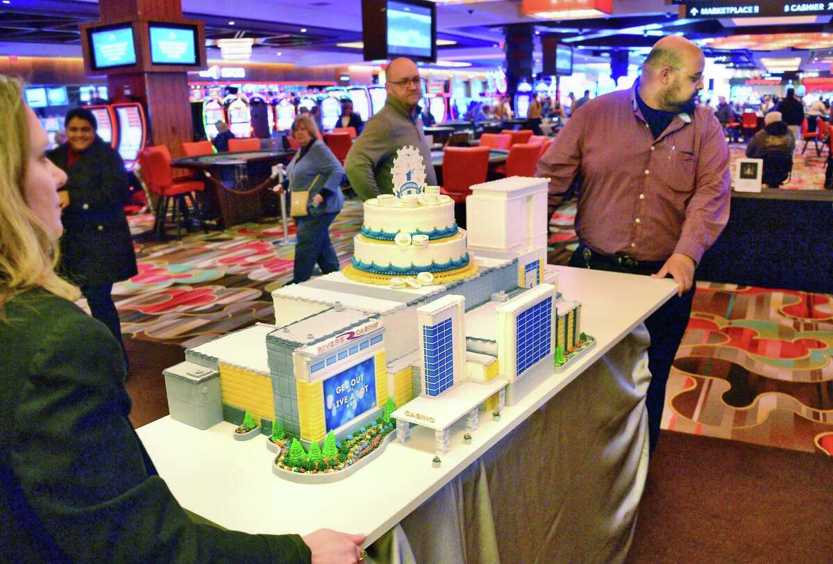 A casino cake is wheeled on to the casino floor during Rivers Casino & Resort Schenectady first anniversary celebration Thursday Feb. 8, 2018 in Schenectady, NY. (John Carl D'Annibale/Times Union)