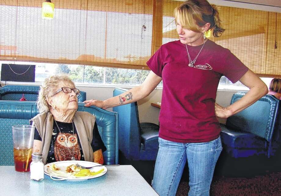 "Bogie's Diner server Tammy Still talks to one of the diner's customers. She says it's fulfilling ""to be able to make a positive impact on them when they come in and to get to know them as unique individuals."" Photo: Roger Deem 