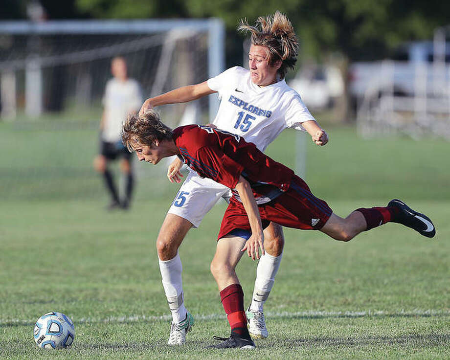 Marquette's Trenton Dietiker (15) scored a goal in the Explorers' 2-1 victory over Belleville East Wednesday night. He is shown in action against Gibault's Logan Doerr (17) during a match earlier this season. Photo: Billy Hurst | For The Telegraph