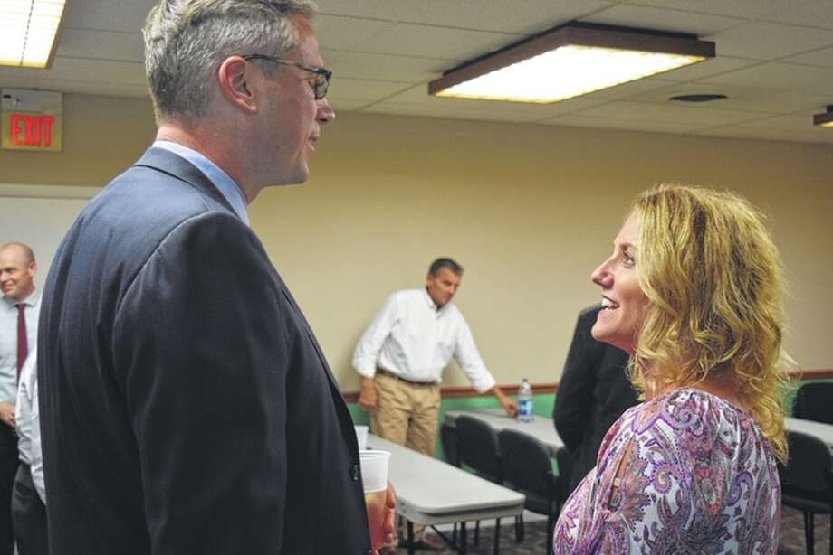 State Treasurer Michael Frerichs speaks with Jacksonville Area Chamber of Commerce President Lisa Musch on Tuesday before giving a presentation about the duties and responsibilities of the treasurer's office. Photo: Greg Olson | Journal-Courier