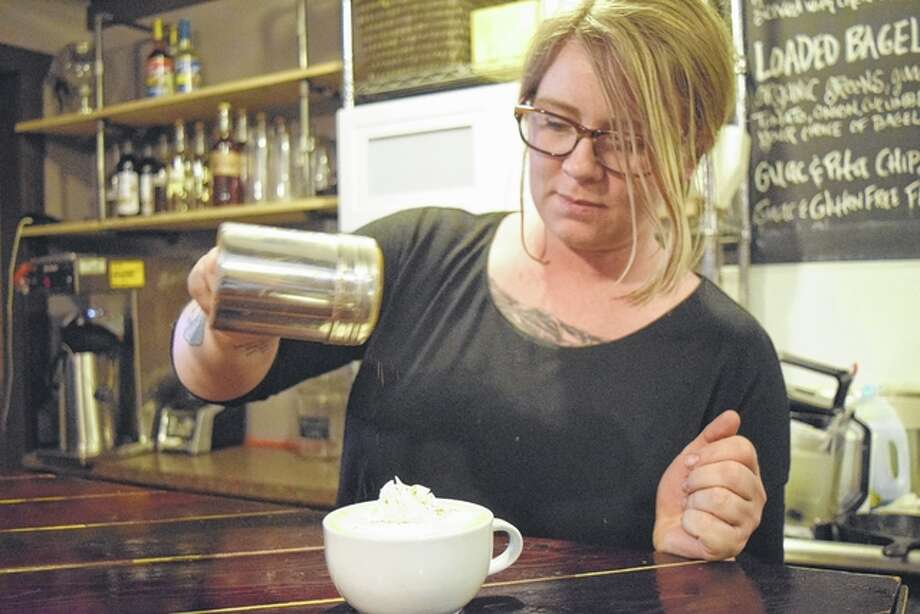 Nicole Riley, owner of The Soap Co. Coffee House in downtown Jacksonville, makes a pumpkin spice latte for a customer Tuesday. Photo: Nick Draper | Journal-Courier