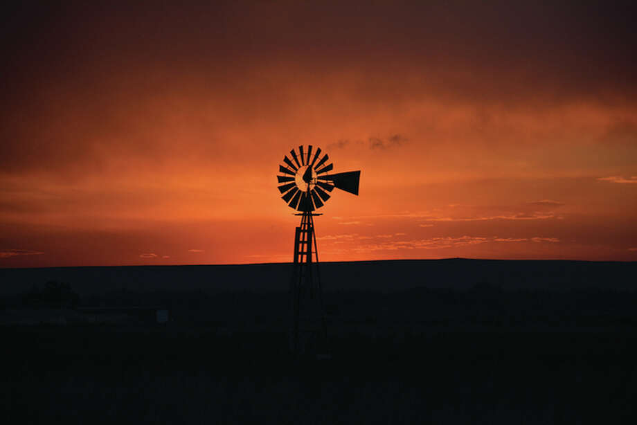 A windmill sits silent and still as the sun sets for another day. Photo: Jeff Ruzicka | Reader Photo
