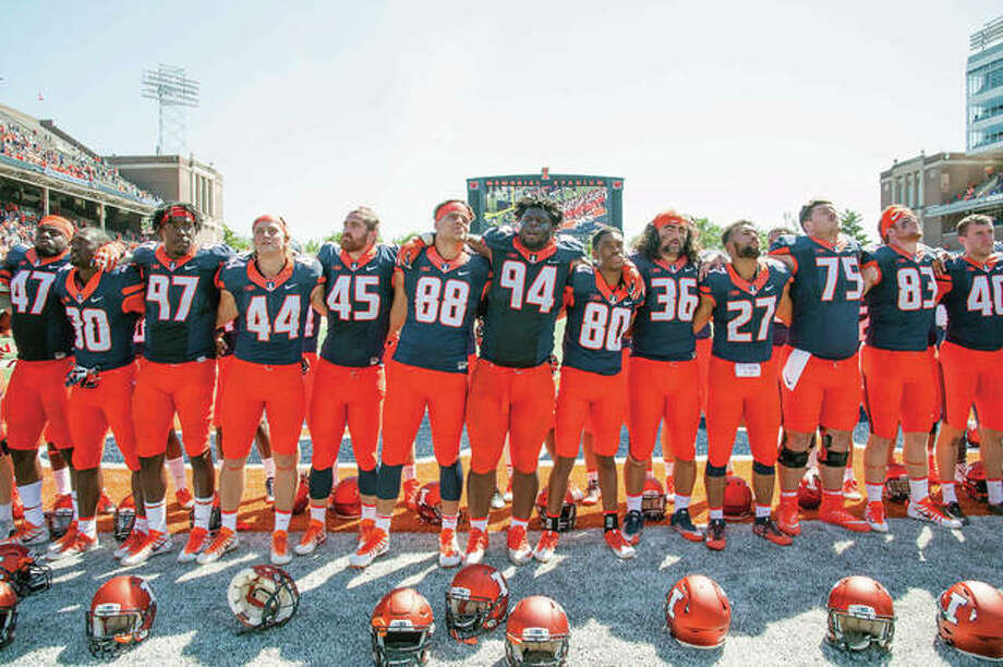 Illinois football players sing the Alma Mater with the band and fans after beating Ball State 24-21 last week at Memorial Stadium in Champaign. The Illini host Western Kentucky Saturday night. Photo: AP