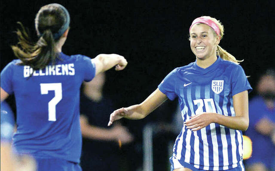 Saint Louis University's Annabelle Copeland (20) is congratulated by teammate Alyssa Seitzer after Copeland scored in the 64th minute of Friday night's 1-1 tie with Kansas at Hermann Stadium in St. Louis. Copeland is a freshman from Marquette Catholic High. Photo: SLU Athletics
